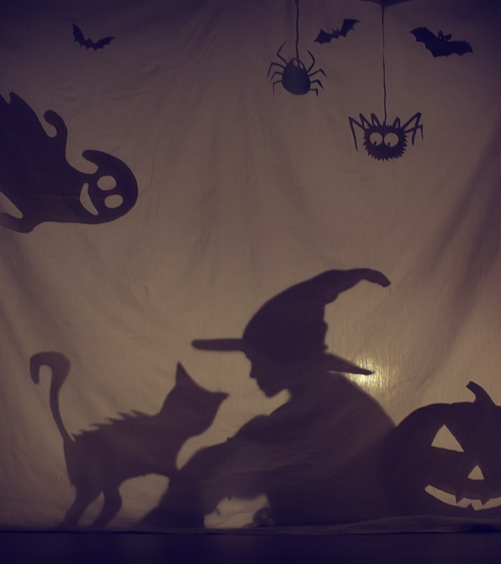 Fabulous shadow little witch of a pumpkin with a cat and a Ghost.The theatre of shadows. . Childhood...