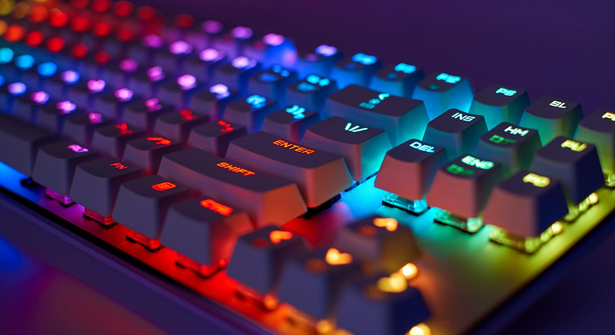 RGB gaming keyboard. Bright colorful keyboard, soft focus. Mechanical keyboard with RGB light, blurr...