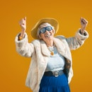 Happy and playful senior woman having fun - Portrait of a beautiful lady above 70 years old with sty...