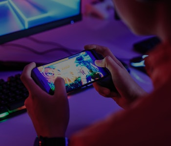 Gamer playing online game on smart phone in dark room. e-Sport Games compilation and Internet Champi...