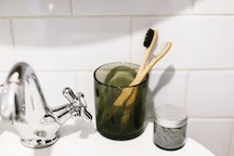 A charcoal-infused toothbrush. Dentists explain what to know about charcoal toothpaste's benefits an...