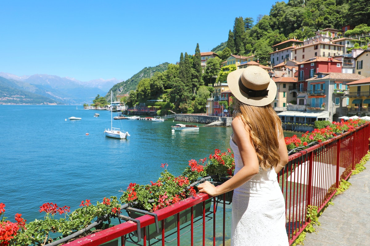 Holidays on Lake Como. Back view of beautiful fashion girl enjoying view of the Walk of Lovers in Va...