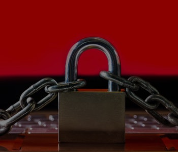 Ransomware,Malware,Encrypt and Hacking Conceptual with Padlock.The Old padlock and Chains On Laptop ...