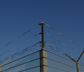 Barbed wire against a blue sky