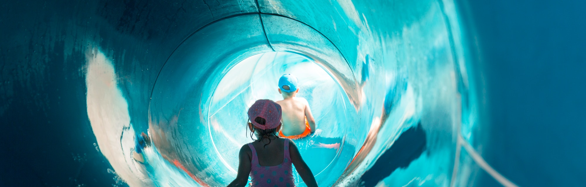 Two children on water slide at aquapark