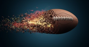 American football ball in fire flying