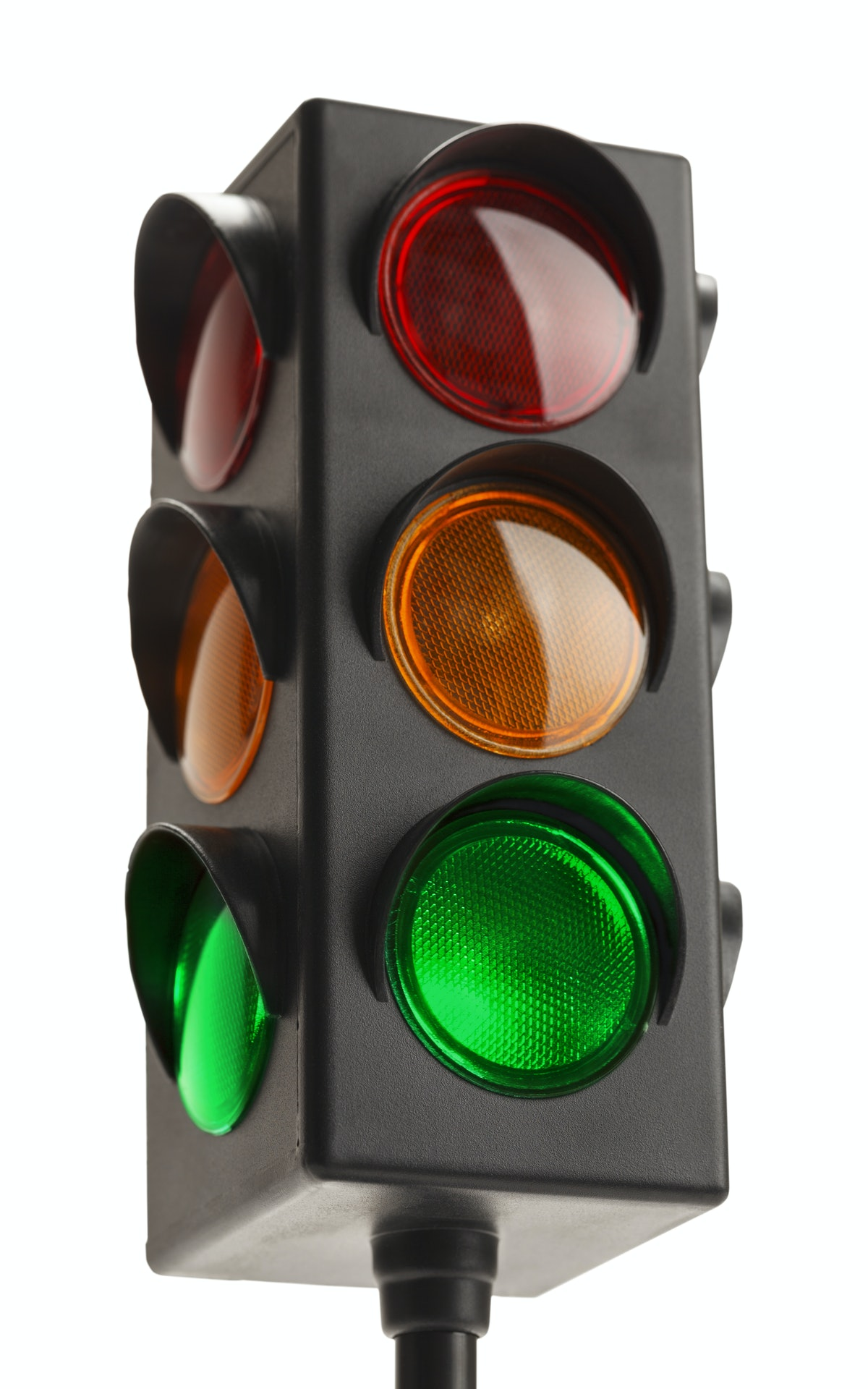 Stop Light With Green Go Signal Isolated on White Background.
