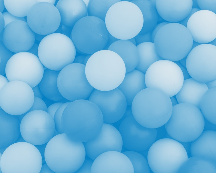 Full frame of multicolored plastic balls in the ball pit (ball crawl). Lots of colorful balls for ch...