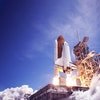 The launch of the space shuttle against the sky, fire and smoke. Elements of this image were furnish...