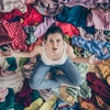 High angle above view photo of stressed helpless lady stay home spring cleaning household sit many c...