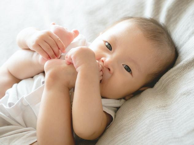Closeup adorable infant Asian baby girl