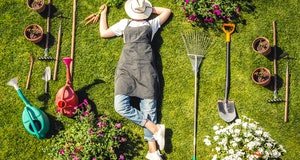Gardening  Gardener Girl Relaxed Lying  Green Grass, Surrounded Gardening Tools With Plants Workplac...
