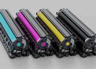 Stack of laser printer CMYK toners. 3D illustration.