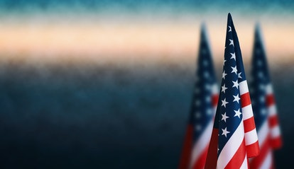 Happy Veterans Day background, American flags against a blue fog background, November 11, American f...