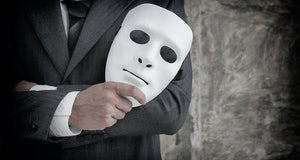 Businessman holding white mask in his hand dishonest cheating agreement.Faking and betray business p...
