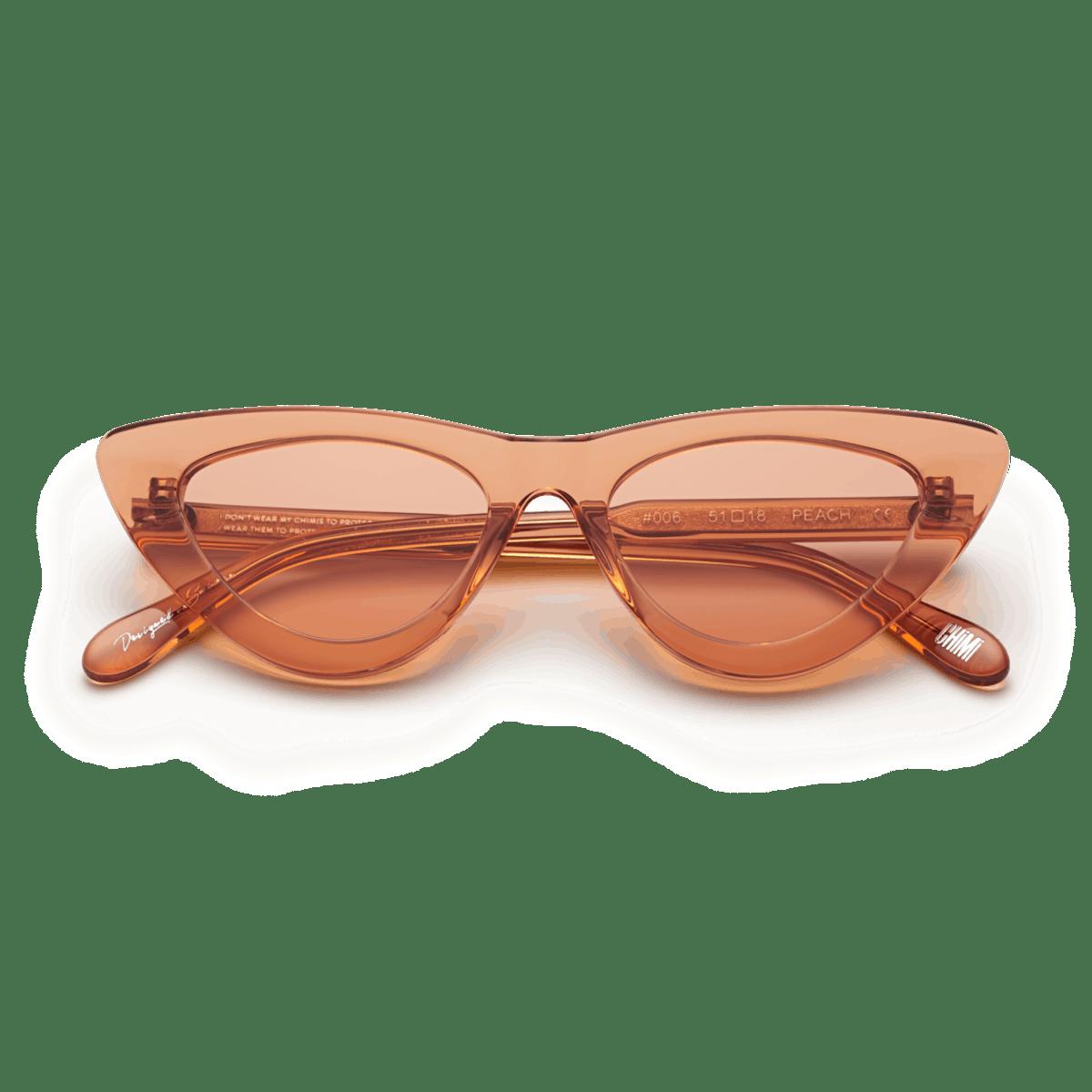 #006 Clear Sunglasses in Peach: image 1