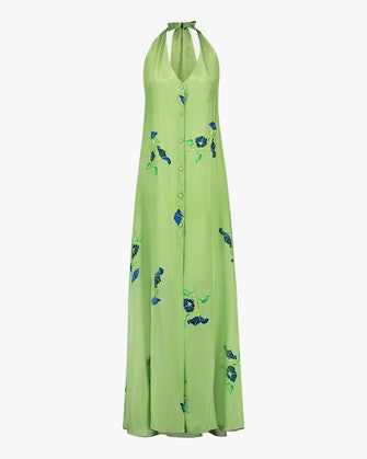 Mala Chetty's bright green button-front halter neck dress with floral designs.