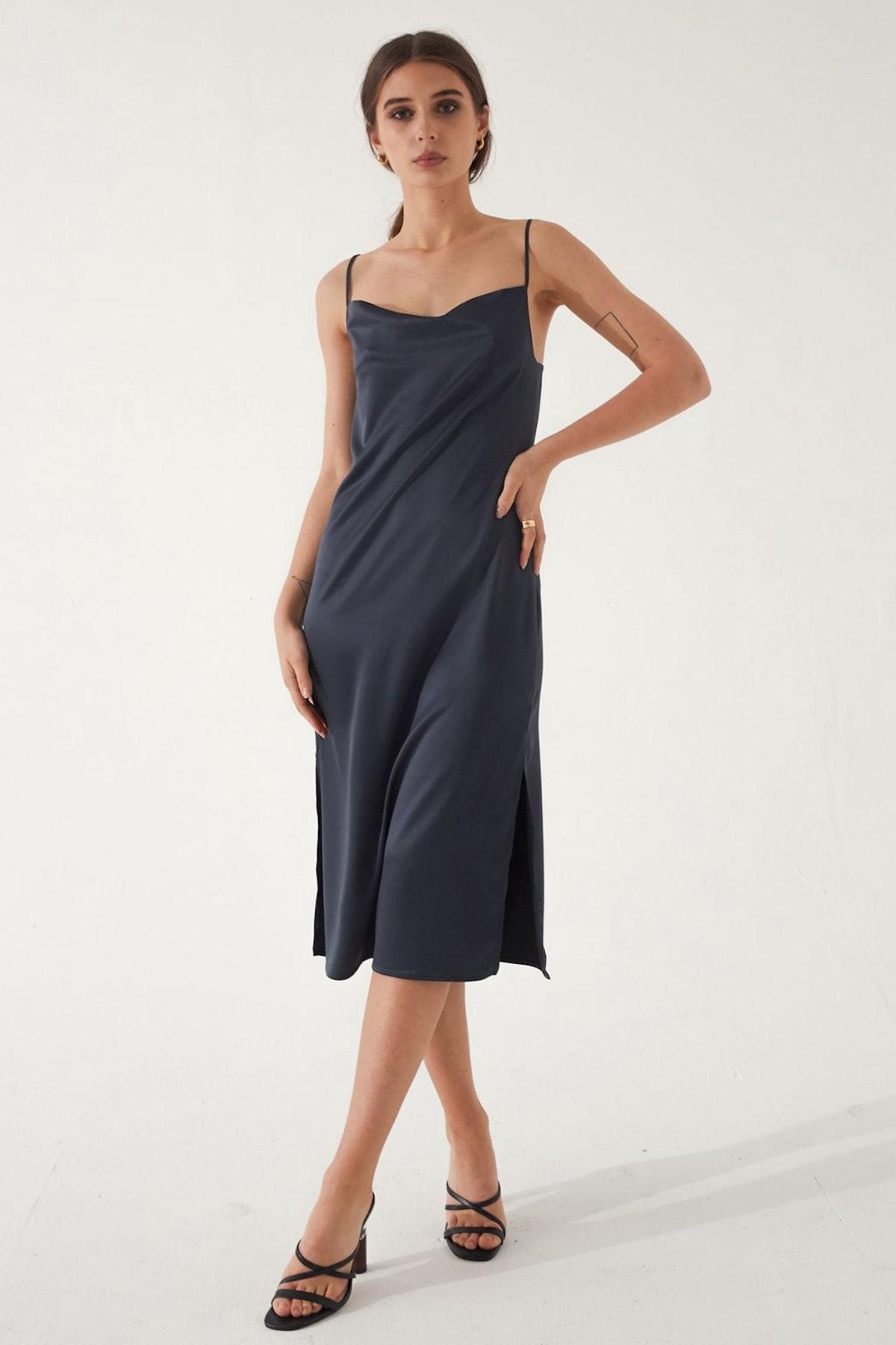 An Almina Concept's black silk slip dress.