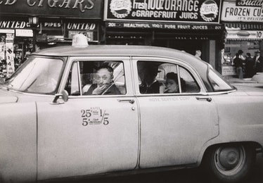 6.%20Taxicab%20driver%20at%20the%20wheel%20with%20two%20passengers,%20N.Y.C.%201956.jpg
