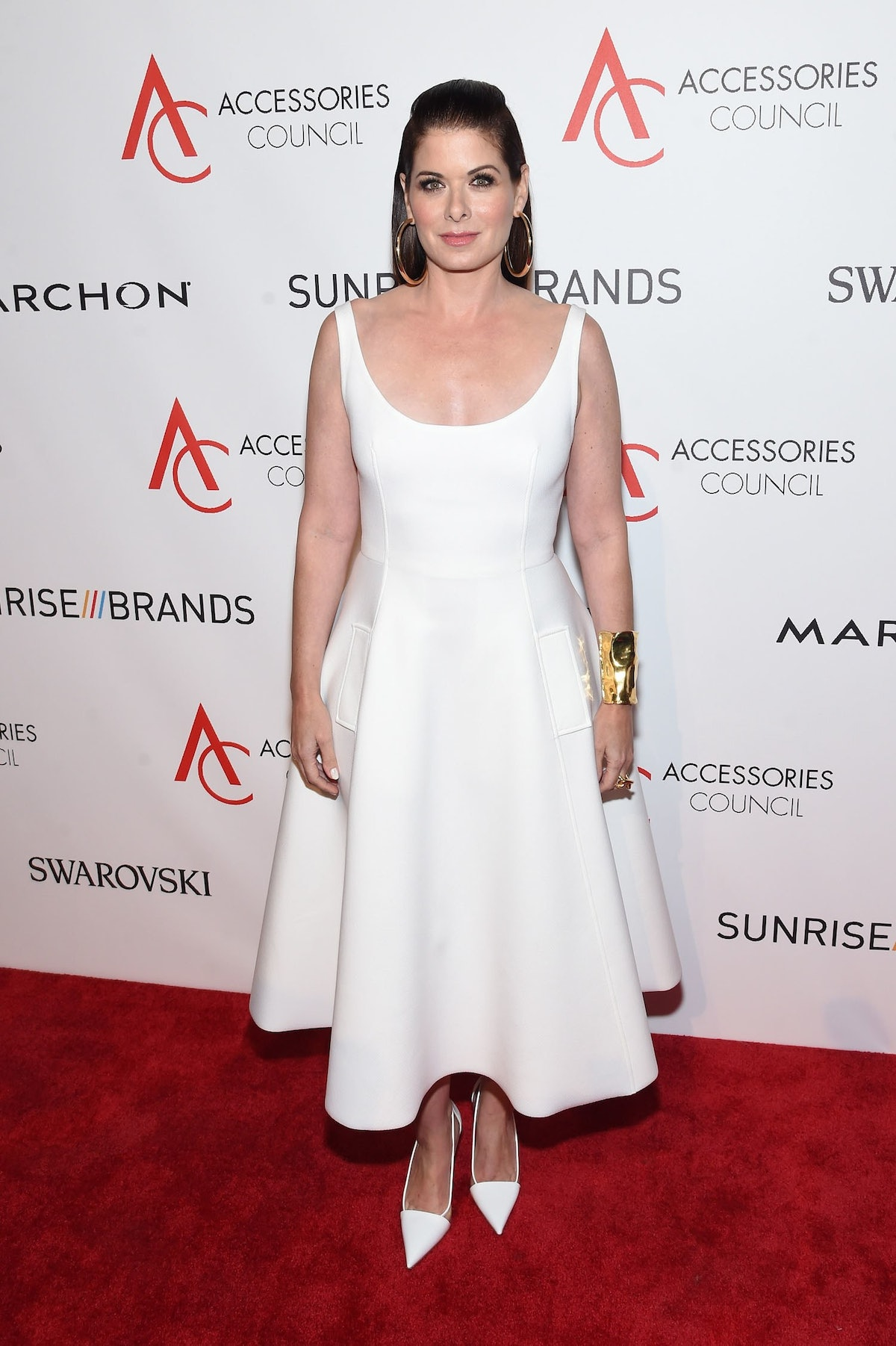Debra Messing presents at the 20th Anniversary of the ACE Awards.jpg