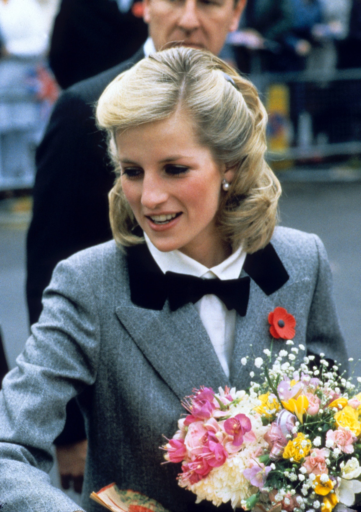Princess Diana with long-ish, straight hair pulled back and a bowtie