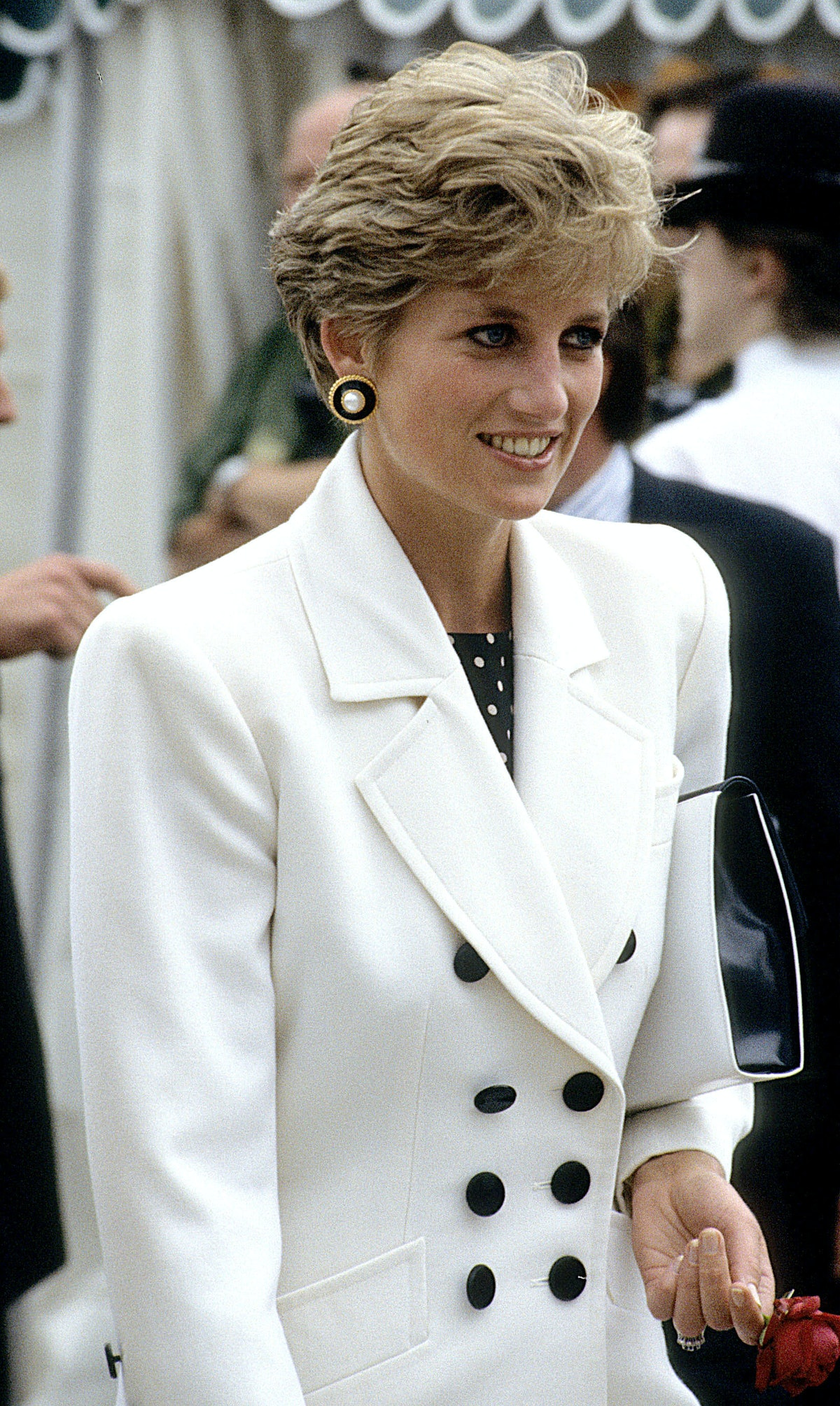 Princess Diana wearing a white blazer with padded shoulders