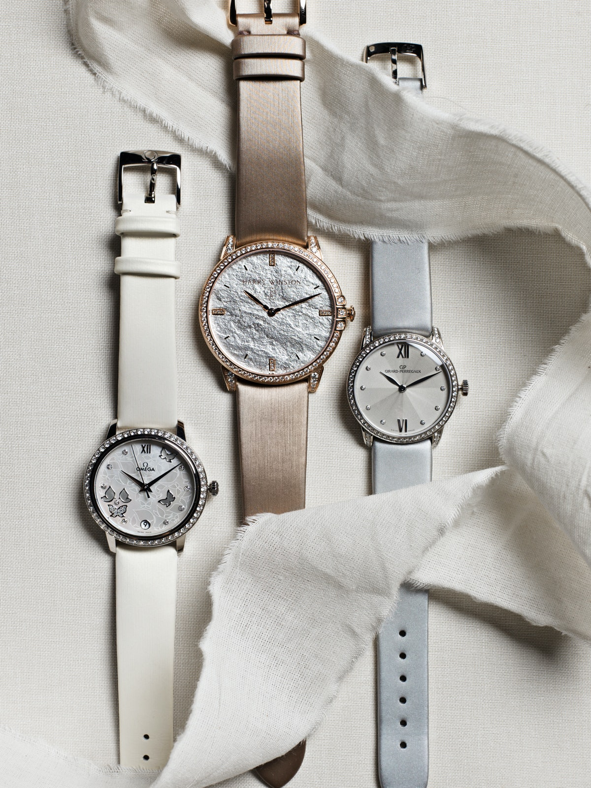Omega gold, mother-of-pearl, and diamond watch