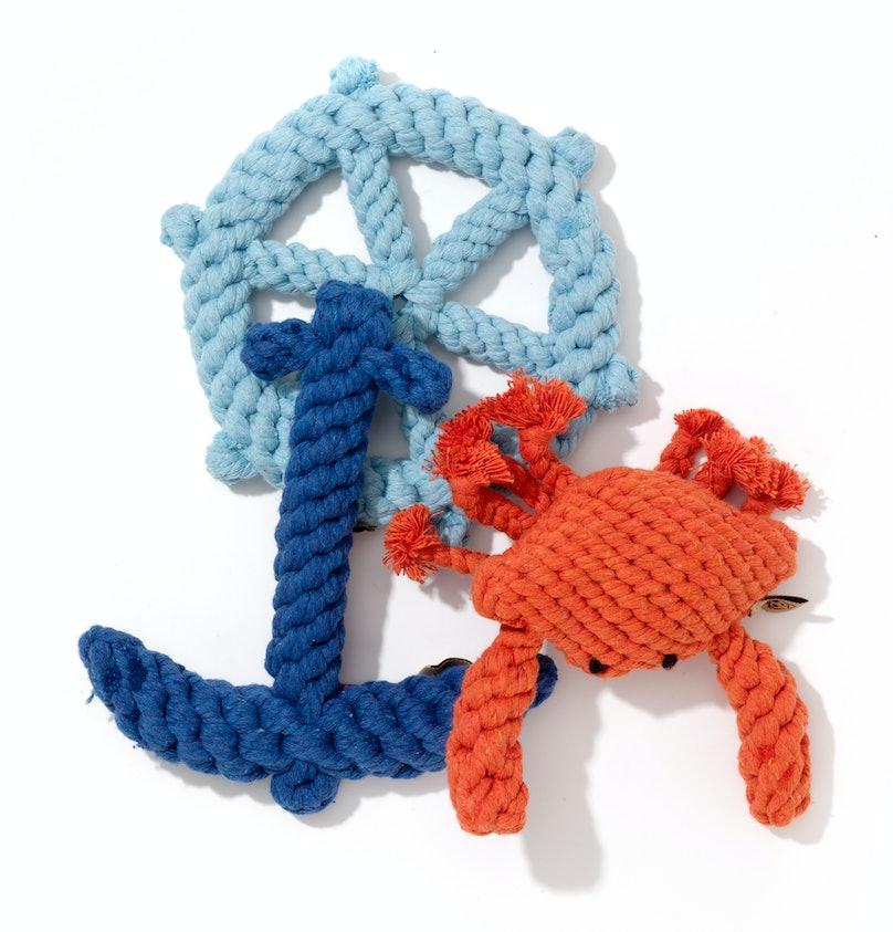 Jax & Bones nautical wheel and anchor toys, $15 each, and crab toy, $16, jaxandbones.com.