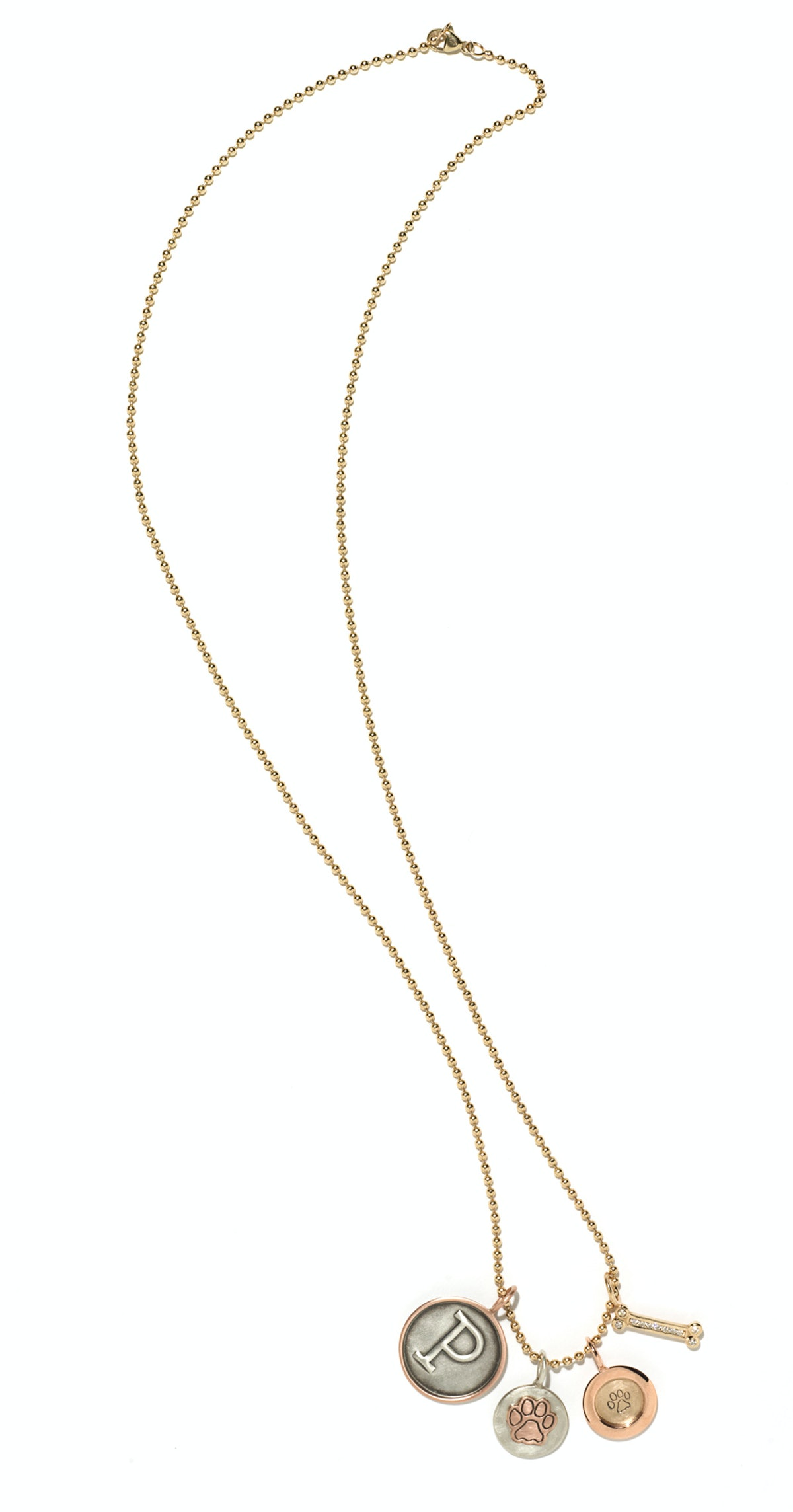 Heather Moore Jewelry gold, sterling silver, and diamond charm necklace, $5,495, heathermoorejewelry...