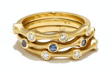 Carelle gold and diamond rings, $1,140 each, and (middle) gold and tanzanite ring, $775, carelle.com...