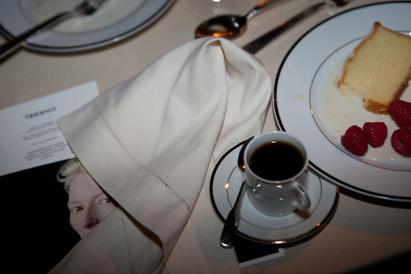 It was [Tilda Swinton](http://www.wmagazine.com/people/celebrities/2008/09/tilda_swinton/)'s birthday. Everyone took exactly one bite of cake just to prove they could do it. Cake. Eat a whole slice. Its the new Everest.