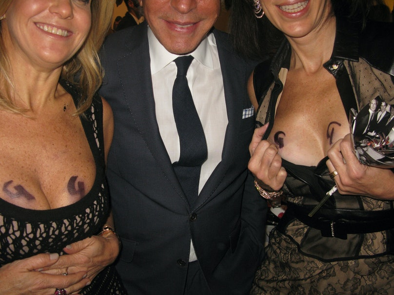 [Giancarlo Giammetti](http://www.wmagazine.com/parties/2013/11/giancarlo-giammetti-valentino-book/photos/) at his Sotheby's book party with two devoted fans. Or is it four devoted fans? You decide.