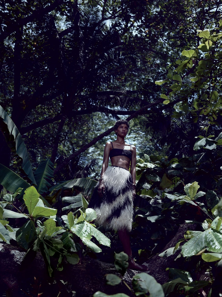 """Caught in the canopy in """"Survival of the Chicest"""" from June/July 2013, shot by Mikael Jansson and styled by Edward Enninful."""
