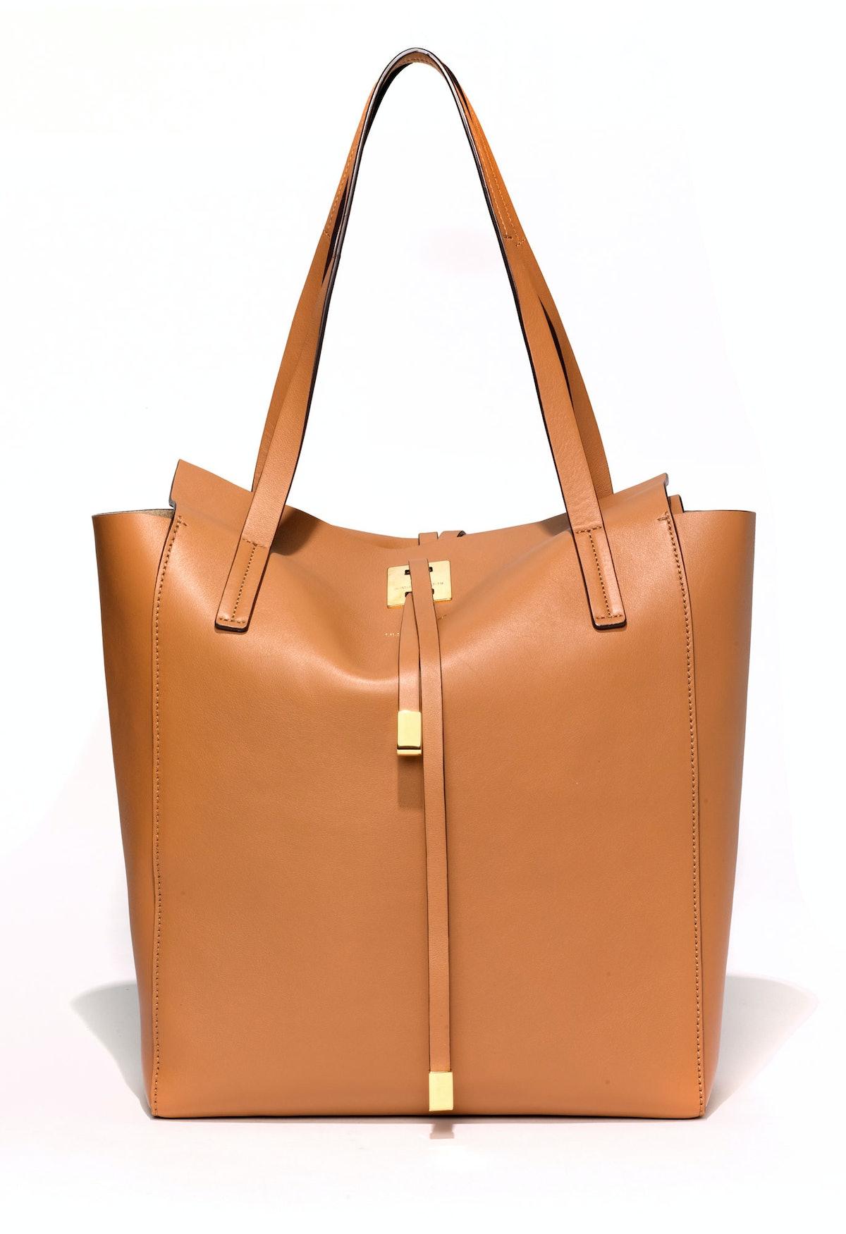 Michael Kors tote bag, $995, select Michael Kors stores, 866.709.KORS.