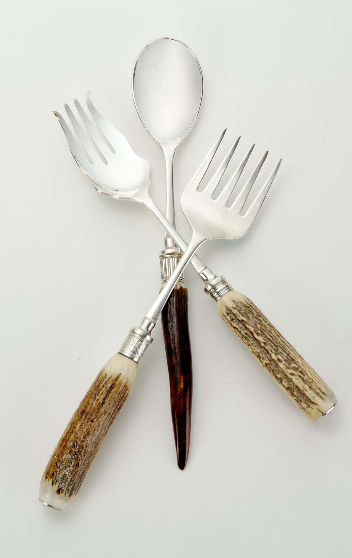 Lynn G. Feld Antiques serving utensils, $295–$495, Bergdorf Goodman, New York, 212.753.7300.