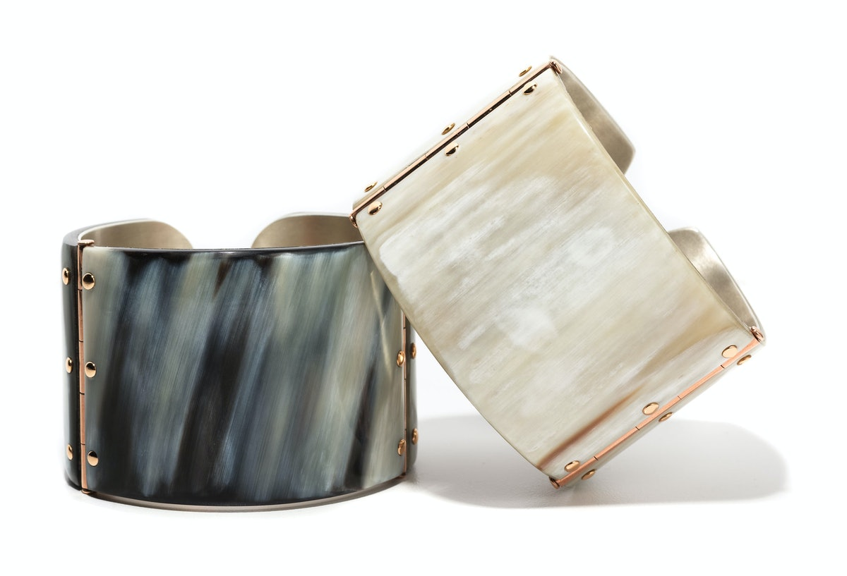 Federica Rettore gold, silver, and zebu-horn cuffs, $5,925 each, Bergdorf Goodman, New York, 212.872.8816.