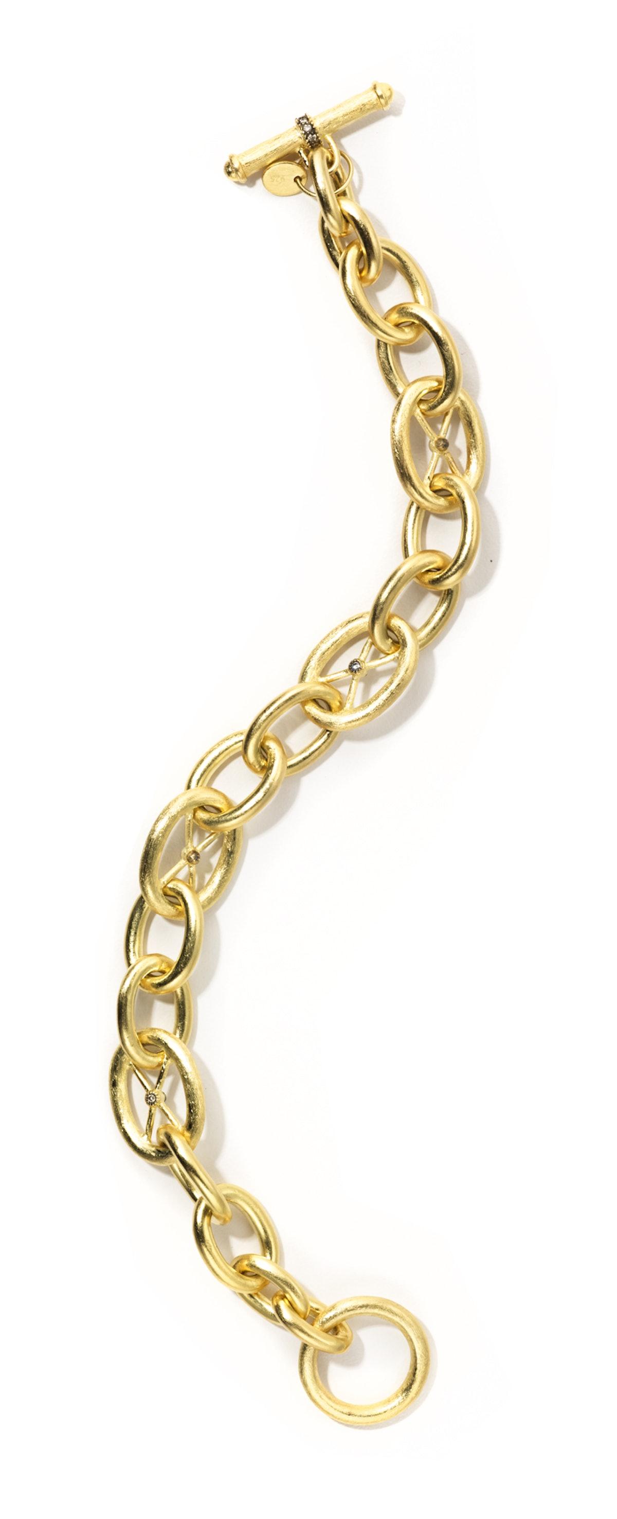 JudeFrances Jewelry gold and diamond bracelet, $3,570, Neiman Marcus, 888.888.4757.