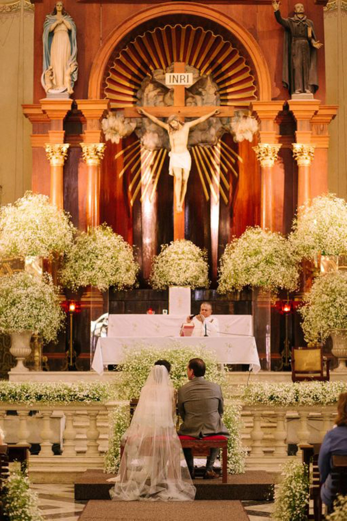 I wanted to keep the decoration in the church simple—I love the elegance of baby's breath.