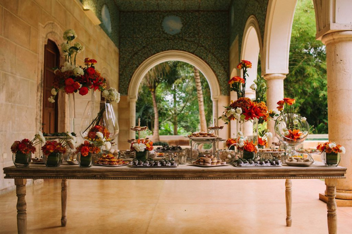 The dessert table was so much fun—and the hand-painted ceiling in the corridor next to the garden wa...