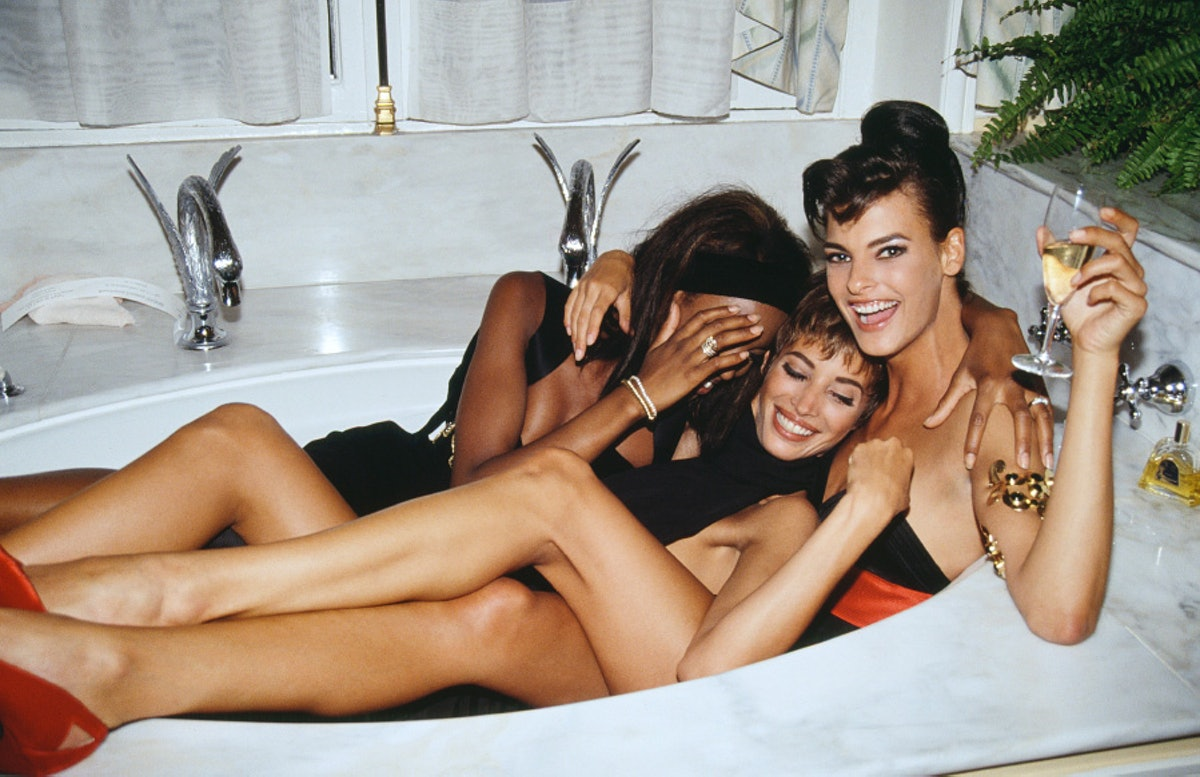 Three models in a tub, Naomi Campbell, Christy Turlington, and Linda Evangelista, 1990.
