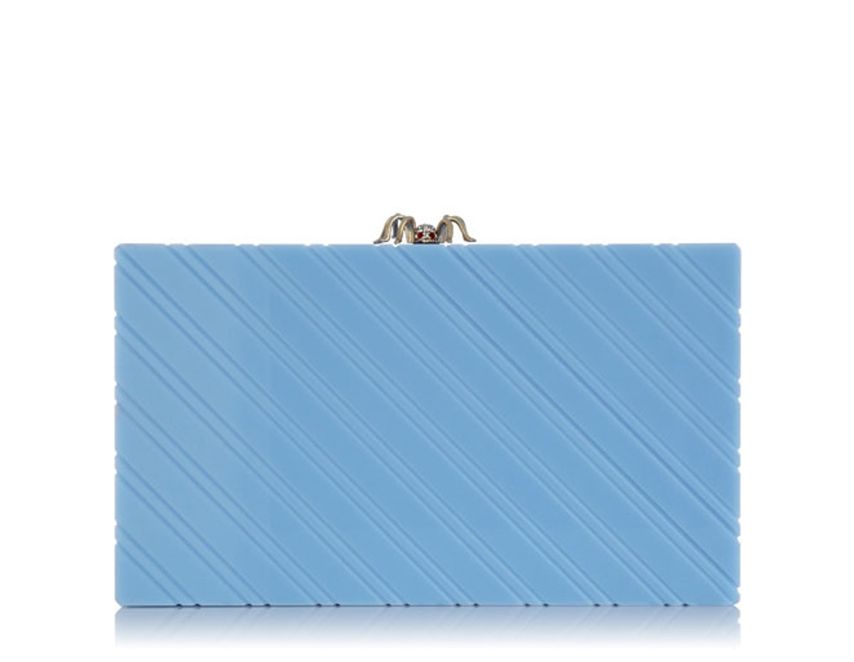 Charlotte Olympia clutch, $1,255, [marissacollections.com](http://www.marissacollections.com/shop/sweet-pandora-clutch-c142098.html?gclid=CL7YpYOntbsCFQrxOgodxF8AsQ).