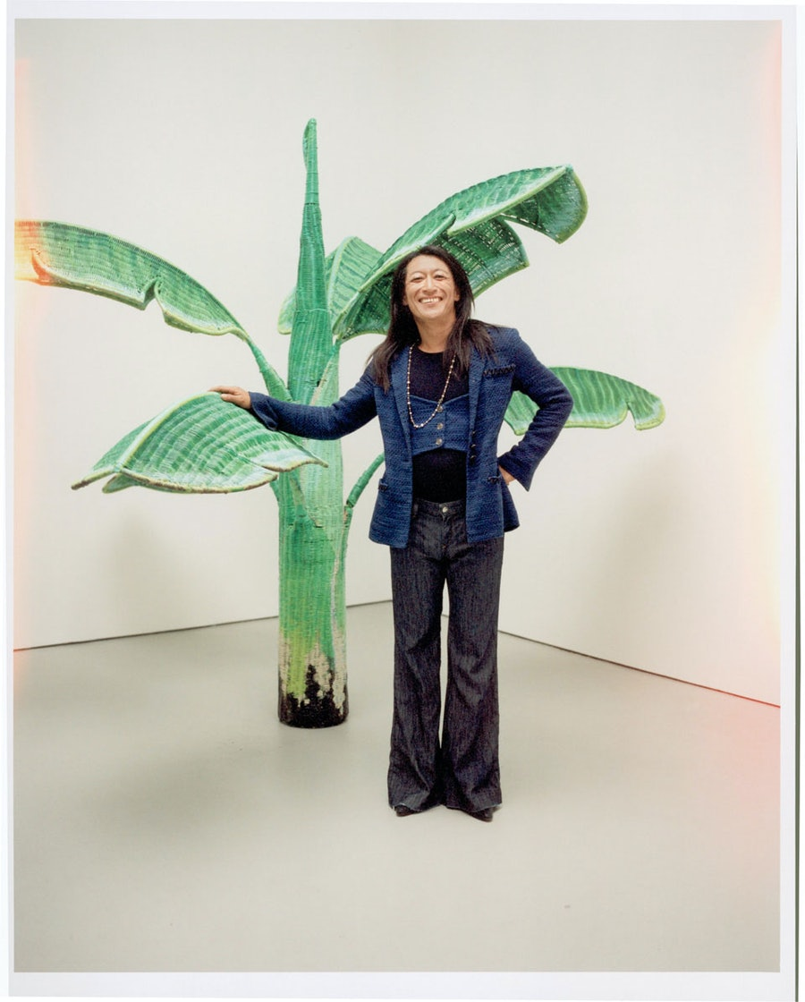 Yutaka Sone in a 2007 Chanel jacket, photographed with his piece Tropical Composition/Banana Tree No. 6, 2008–2010, at David Zwirner Gallery in New York.