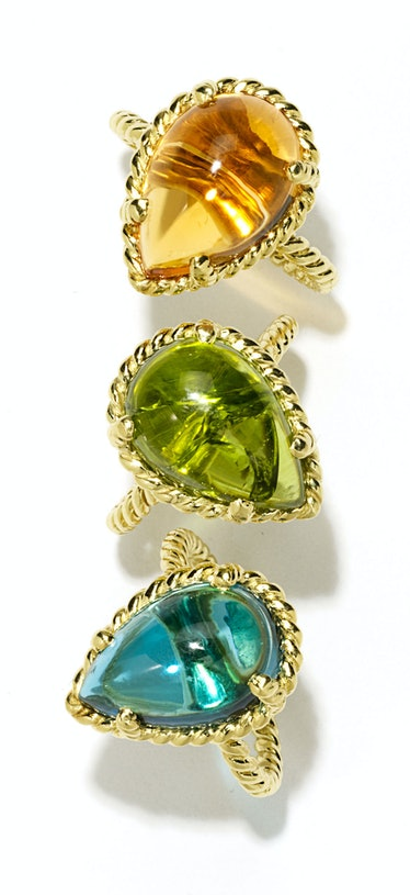Cassis (from top) gold and citrine ring, $1,620, gold and peridot ring, $5,095, and gold and topaz r...