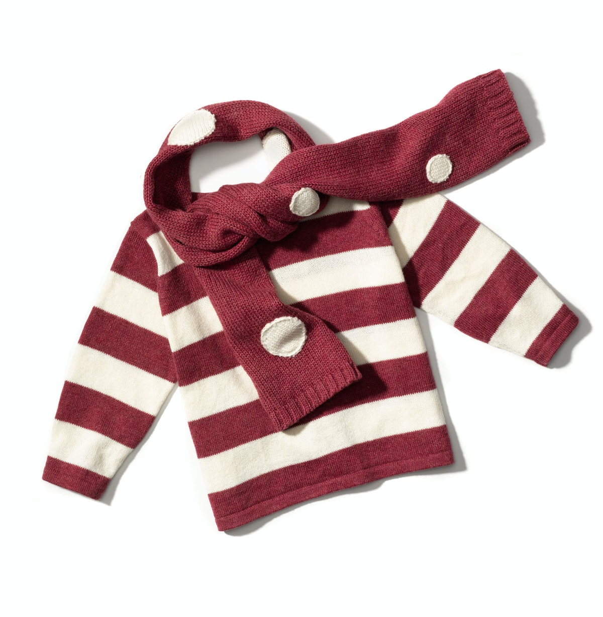 Tane Organics scarf, $48, and sweater, $98, [taneorganics.com](http://www.taneorganics.com/).