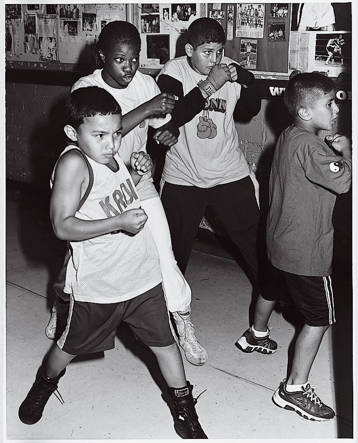 """Throwing punches in """"Welcome to the Motor City,"""" shot by Bruce Weber and styled by Camilla Nickerson, September 2006."""