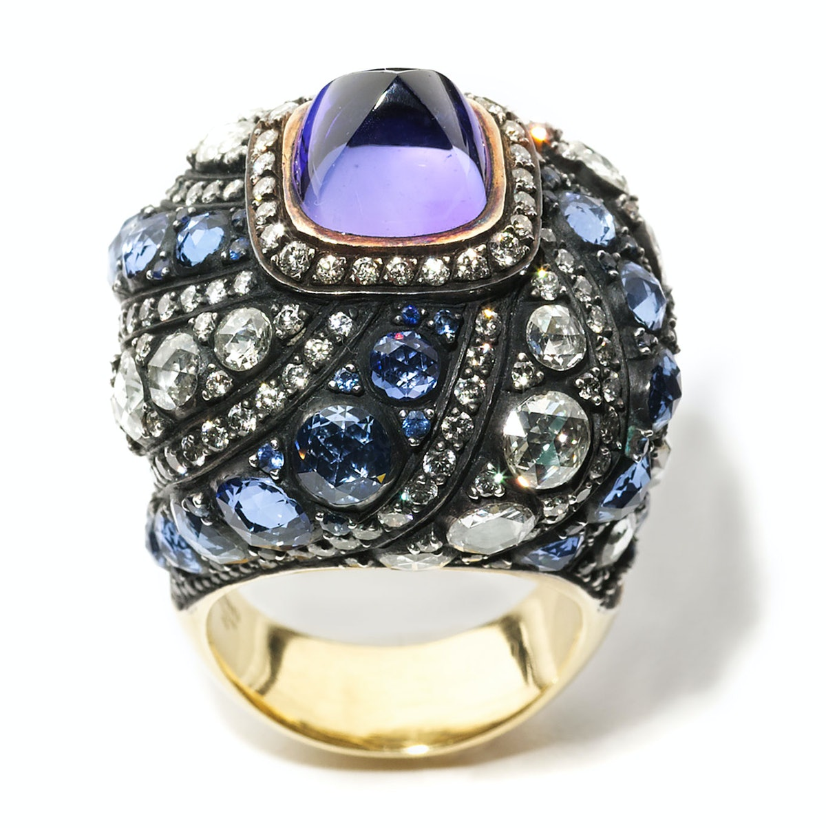 Gilan gold, tanzanite, sapphire, and diamond ring, $65200, [Bergdorf Goodman](http://www.bergdorfgoodman.com), New York, 212.753.7300.