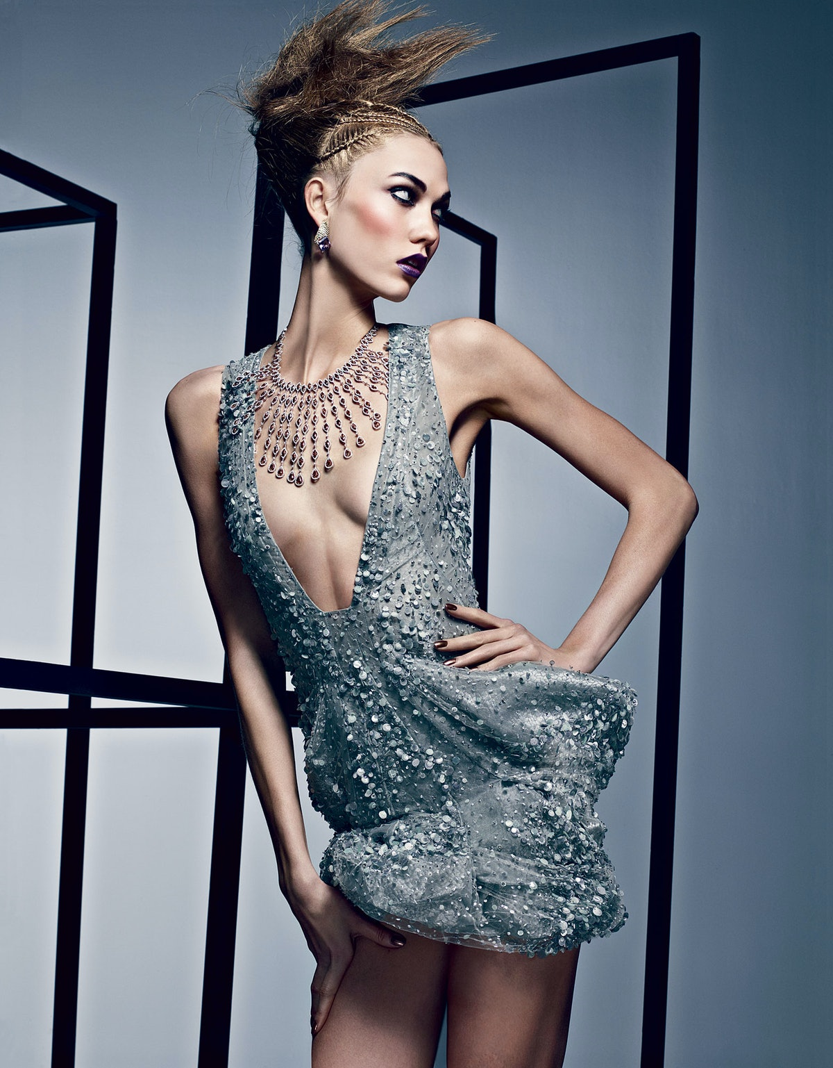 """Striking a pose for """"[Drama Queen](http://www.wmagazine.com/fashion/features/2012/03/karlie-kloss-drama-queen-ss/photos/),"""" shot by Craig McDean and styled by Lori Goldstein for April 2012."""