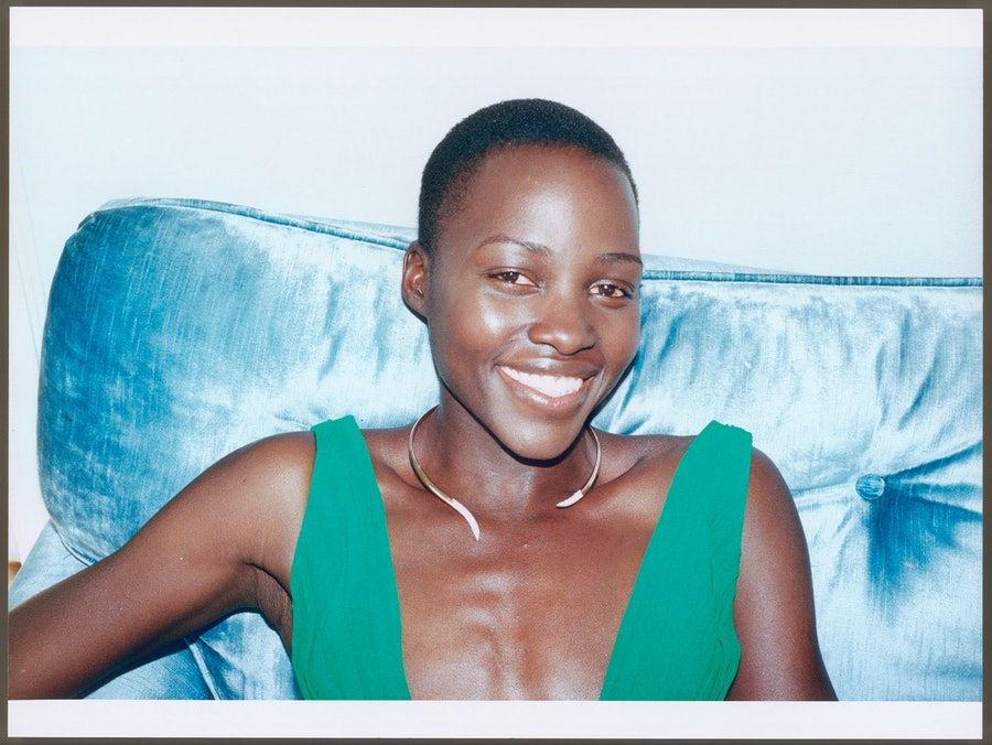 """__Lupita Nyong'o__ in *12 Years a Slave*       """"When I got the role in *12 Years a Slave*, I called my father and said, 'Daddy, I got a part in a movie! Do you know Brad Pitt?' And he said, 'I've heard of him, but I don't know him personally.' I said, 'Well—he's producing this movie, and he's really big in Hollywood.' My father paused and then said, 'So you have a job! Good. Congratulations! And good night!' That call put everything in perspective.       Saint Laurent by Hedi Slimane dress; Ana Khouri necklace."""
