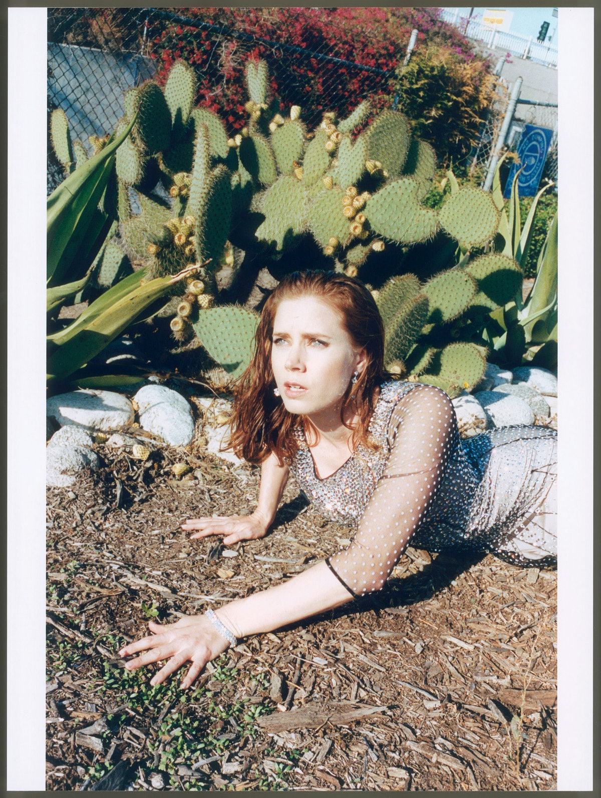 """__Amy Adams__ in *American Hustle* and *Her*       """"I learned to like auditions. I didn't get most of the jobs, so I viewed auditions as my only opportunity to act. I was invested: I would dress the part. When I tried out for Catch Me If You Can, my character had braces, and I wore teeth-whitening trays to the audition—I wanted the sensation of something awkward being in my mouth, of sounding lispy. Amazingly, I got the part.""""       Blumarine gown; Van Cleef & Arpels earrings and bracelet."""