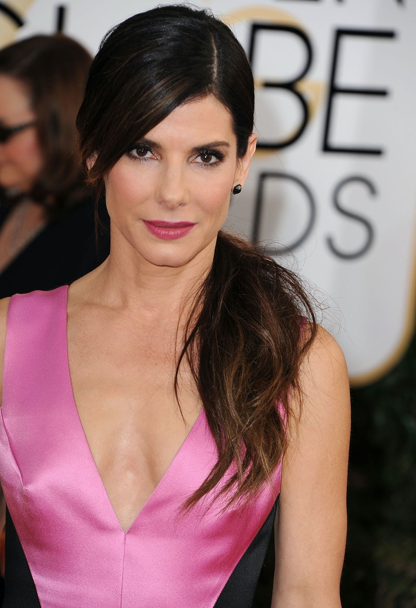 Not many do a side pony better than __Sandra Bullock__, and her chic makeup, with that impactful dusty rose lip epitomized elegance.
